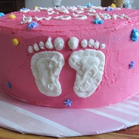 Baby Shower Cake 2011   Just a 9 inch round cake with buttercream frosting and buttercream decorations.