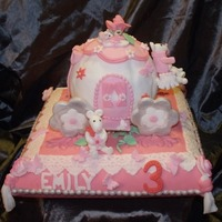 1317073065.jpg   princess coach cake for my grandaughter Emily..