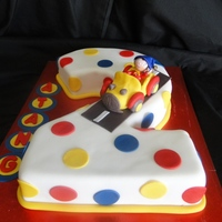 Noddy Cake Vanilla sponge cake covered in fondant. Noddy Car and Noddy are both made from sugar paste.