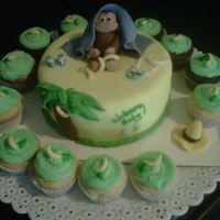 Curious George Baby Shower Cake all covered in fondant, monkey made of fondant,