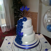 Royal Blue Rose Cascade vanilla 10inch 8 choc and 6 vanilla, all roses from sugar paste with diamantees in some roses