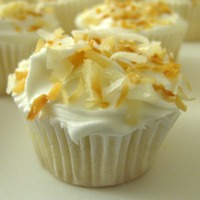 Tropical Cupcakes Coconut cake with a pineapple coconut buttercream finished with freshly toasted coconut.