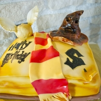 Harry Potter Everything of this cake is edible, Snatch is a cake pop, the hat is fondant. Cake is a rainbow cake with irish cream colored with...