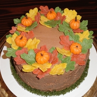 Fall Birthday Vanilla cake, chocolate buttercream, with marzipan leaves and pumpkins.