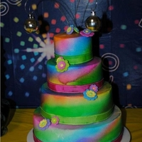 70's Cake My parent's renewed their wedding anniversary and did a 70s theme. Tye-dye cake with disco balls as topper. The Tye-dye was for the...