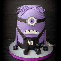 Purple Minion Cake Purple Minion from Despicable Me 2 for a 40th birthday. :)The hair was the worst part. :( I wanted to find some purple cotton candy, but...