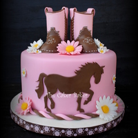 Cowgirl Cake Gumpaste boots and cut out of a horse silhouette. I really enjoyed making this cake. :)