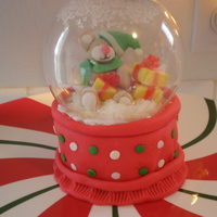 "Mini Snowglobe Cake I found this idea on Bakerella's site (love her!). It is a 3"" cake with gumpaste figures and Starburst gifts."