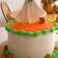 Ghost Halloween Cake Chocolate Cake filled with buttercream icing and topped with buttercream as well. The girl ghost is made from gumpaste.