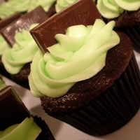Andes Mint Cupcakes Chocolate cupcakes with mint flavored cream cheese icing and topped with an Andes Mint.
