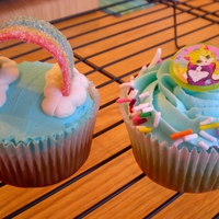 Rainbow Cupcakes Cupcakes decorated with rainbow candy straps, sprinkles, and toy rings.