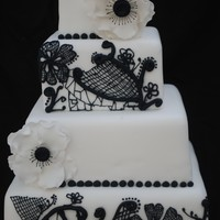 Black & White Piped Lace & Anemones  I have been wanting to try the piped lace effect for a while, so came up with this design for a dummy cake. Piping in black RI (I used the...