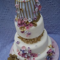 Golden Birdcage Wedding Cake I was inspired to turn the birdcage cake into a wedding cake, and here is the result. One of my first dummy cakes for my portfolio. I'...