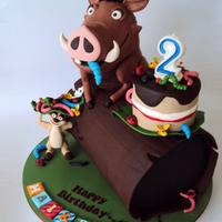 Hakuna Matata! Pumba And Timon  Pumba and Timon are sculpted from Rice Krispie Treast and decorated with Gumpaste, the Log is all cake. With a Gumpaste Bug decorated Smash...
