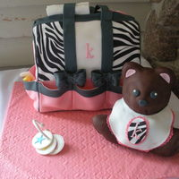 "Amy's Animal Print Diaper Bag  2 11x15 cakes cut in thirds and stacked for a total of 6 2"" caktall cakes. Bag is fondant, bear is covered in modeling chocolate. I..."