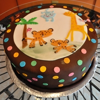 Animal Theme Baby Shower Cake This cake was decorated to match the theme of the baby shower. The animals were made with gumpaste and the dots were made of fondant. The...