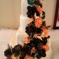 Tiered Flower Cascade My second wedding cake, my first cascade. Brown and peach roses and chrysanthemums in varying degrees of color. The top starts the darkest...