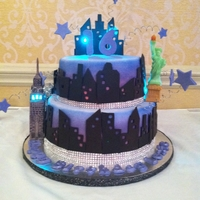 Nyc Sweet 16 Cake!  This cake was created for a NYC sweet 16 theme. The cake was covered in whit fondant and then airbrushed in pink, purple, and blue. The...