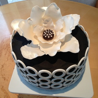 Black/white Sophisticated Birthday Cake Chocolate cake w/Italian custard and fresh raspberry filling. Chocolate B/C frosting with gum paste flower and circles. I saw this on here...