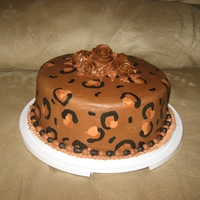 Sue's Cake animal print (cheetah-ish)chocolate cake with chocolate buttercream and hand formed chocolate roses