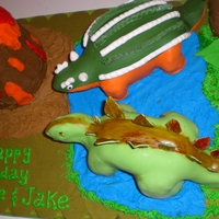 Dinosaur With Volcano My twin grandsons wanted this cake so bad and was so willing to let me know how many plates one dinosaur had and what colors to use for the...