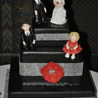 Black And Bling Wedding Simple design, with bling ribbon and a fantasy rose with gem center (gem and ribbon not-edible). Gumpaste figures of the bride, groom, and...