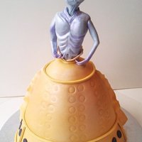 Alien Bride   layer upon layer of white chocolate mud cake and real raspberry BC, covered in fondant, hand made fondant alien...