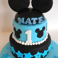 Mickey Mouse  two tier chocolate cake, chocolate butter cream filled, fondant coveredI had seen alot of minnie cakes in this style but no blue boys ones...