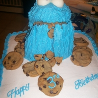 Cookie Monster   RKT Cookie monster on top of a cookies and creme cake.trimmed with chocolate chip cookies