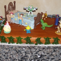 Andy's Room Toy Story cake. Used figurines for characters. Covered cake in woodgrain fondant. Covered bed caket in quilted fondant. Melted chocolate...