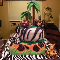 Jungle Themed Birthday Cake Gumpaste figures. Pretzel trees with fondant leaves. Had difficulty with the trees leaning. I guess too top heavy. Additional photo shows...
