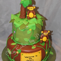 Twins Monkeys Theme Shower Cake This baby shower cake is for a young lady who is having twins. So, she wanted monkeys on her cake so what I did was gave her twin monkeys...