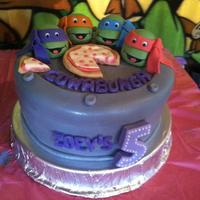 Ninja Turtles Teenage Mutant Ninja Turtles cake for my niece's birthday. Turtles are made from fondant. This cake was so much fun to make!