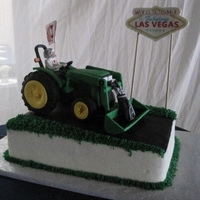 Groom's Cake The bride requested 5 elements to be incorporated on her groom's cake. So, the groom is driving a TRACTOR, wearing a DALLAS COWBOYS...