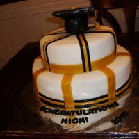Graduation Cake Fondant strips laid on round cakes. No time to do the balls, drove 12 hours to deliver it.