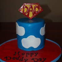 "Super Dad, Fathers Day Cake  6"" tall, 6"" round. Red Velvet, ganache and Duff's Fondant. Tried it for the first time. Its pretty easy to work with and..."