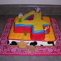 Toy Story Number 4 Cake The customer wanted a number Toy Story number 4 for her sons 4th birthday. I knew that wouldn't be enough cake for the amount of...
