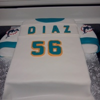 Dolphins Jersey I made this Miami Dolphins football jersey for my uncle who turned 56 (hence #56) :) It was vanilla cake with vanilla filling & icing...