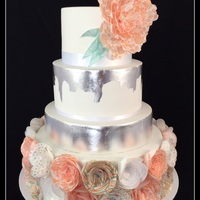 Coral And Mint Wafer Paper Wedding Cake With Silver Leaf  Printed wafer paper in coral and mint patterns tied this cake in with the happy couple's wedding decorations. This is the first time I...