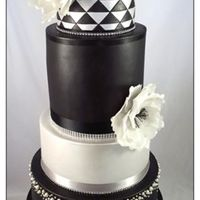 Black And Silver Wedding Cake  I love this cake! It is based on a Sweet Art design the bride found. The flowers are wafer paper peonies and there are edible silver...