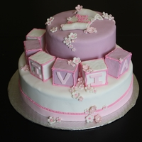 Cubes And Flower Cake Baby shower cake. Sugar paste with vanilla frosting under.