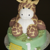 Girafe Plush Cake Birthday cake make with sugar paste on chocolate cake. Head made of Rice Krispie's Treat.
