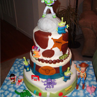 Toy Story Cake  I made this cake for the Make A Wish Foundation. I completely forgot to put the top tier on, which was blue with white clouds and had the...
