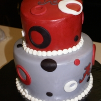 Alabama Topsy Turvy Cake This was my first topsy turvy cake. I used Sharon Zambito's dvd to make this cake. It was covered in rolled buttercream, also my first...