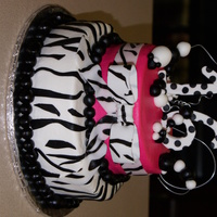 Purple Zebra Cake Customer wanted small cake with the 2 tier effect so I torted each tier and filled it. It is buttercream with fondant decorations. This was...