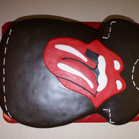 "Rolling Stones This was a 1/4 sheet cake and I didn't want to ""waste"" any cake so it looks a little funny. Suppose to be a t-shire...."