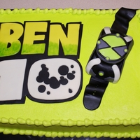 Ben 10 Single layer 1/2 sheet cake covered in buttercream and fondant decorations. Made the watch with rice krispy treats covered in fondant.