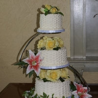 3 Tier Basket Weave Cake 3 TIER BASKET WEAVE FRENCH VANILLA CAKE WITH BUTTERCREAM ICING AND FAKE FLOWERS