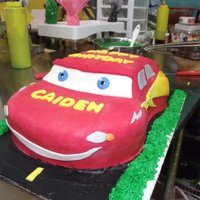 Lightning Mcqueen  My first sculpted cake. I hadn't realized that I had missed the H in birthday until after I took the picture! lol, I fixed it, but I...