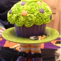 Giant Halloween Cupcake This cake was made for my children's halloween party at our home. I saw this cake stand couldn't resist using it as inspiration....